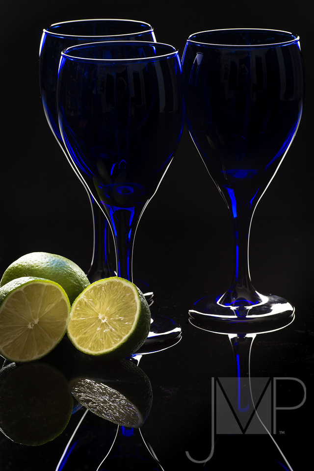 Limes with Blue Glass on Black